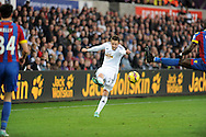 Gylfi Sigurdsson has his shot defelected by Yannick Bolasie of Crystal Palace.<br /> Barclays Premier league match, Swansea city v Crystal Palace at the Liberty stadium in Swansea, South Wales on Saturday 29th November 2014<br /> pic by Phil Rees, Andrew Orchard sports photography.