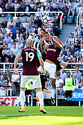 Newcastle United forward Aleksandar Mitrovic (#45) and Newcastle United defender Ciaran Clark (#2) challenge for the ball in the air against West Ham United defender Pablo Zabaleta (#5) during the Premier League match between Newcastle United and West Ham United at St. James's Park, Newcastle, England on 26 August 2017. Photo by Craig Doyle.