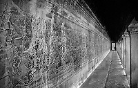 Stone frescoes line an exterior alleyway of one of the Angkor Wat temples, Siem Rep, Cambodia.