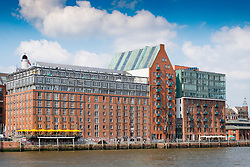Old warehouse buildings converted to luxury apartments and offices on waterfront of River Elbe in Hamburg Germany