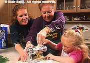Mother, daughter and grandchild make noodles