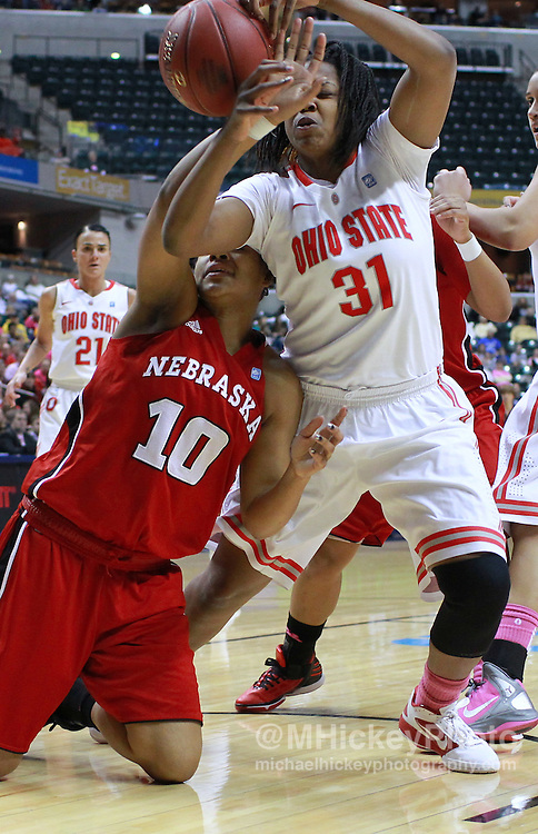 March 03, 2012; Indianapolis, IN, USA; Nebraska Cornhuskers forward Meghin Williams (10) and Ohio State Buckeyes guard Raven Ferguson (31) battle for a loose ball under the basket during the semifinals of the 2012 Big Ten Tournament at Bankers Life Fieldhouse. Mandatory credit: Michael Hickey-US PRESSWIRE