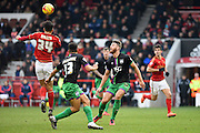 Nottingham Forest striker Tyler Walker wins the ball in the air watched by Bristol City's Nathan Baker and Scott Golbourne  during the Sky Bet Championship match between Nottingham Forest and Bristol City at the City Ground, Nottingham, England on 27 February 2016. Photo by Jon Hobley.