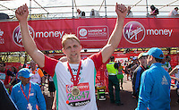Lewis Moody at the end of the Virgin Money London Marathon 2014 on Sunday 13 April 2014<br /> Photo: Roger Allan/Virgin Money London Marathon<br /> media@london-marathon.co.uk