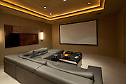 Empty media room with leather furniture in luxury villa