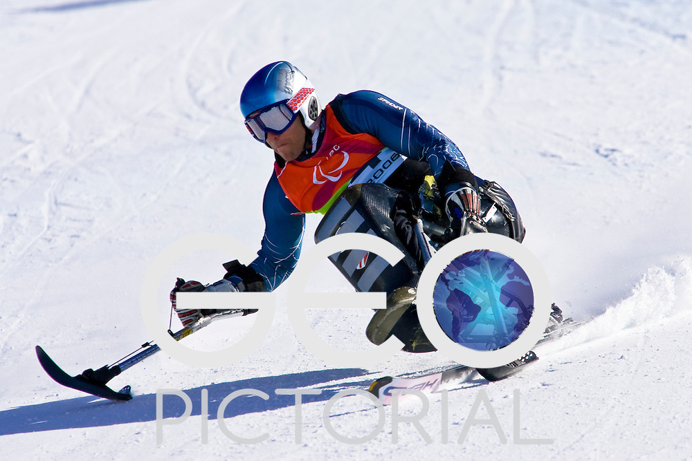 SESTRIERE COLLE, ITALY - MARCH 17th : Nick Catanzarite of the USA in the Mens Alpine Skiing Giant Slalom Sitting competition on Day 7 of the 2006 Turin Winter Paralympic Games on March 17th, 2006 in Sestriere Borgata, Italy.
