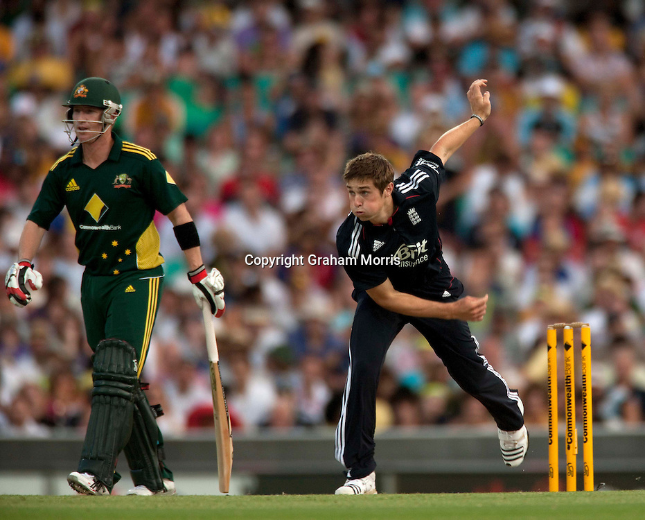 Chris Woakes bowls for the first time in a fifty over international (past Brad Haddin) during the third one day international between Australia and England at the SCG in Sydney, Australia. Photo: Graham Morris (Tel: +44(0)20 8969 4192 Email: sales@cricketpix.com) 23/01/11