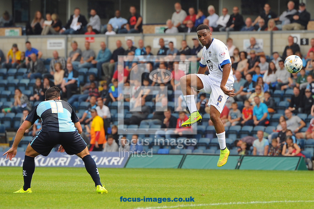 Kelvin Etuhu of Bury controls the ball in mid-air to take it away from Sam Wood of Wycombe Wanderers during the Sky Bet League 2 match at Adams Park, High Wycombe<br /> Picture by Seb Daly/Focus Images Ltd +447738 614630<br /> 06/09/2014