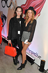 Left to right, CHARLOTTE DE CARLE and MILLIE MACKINTOSH at the launch of The Lulu Perspective to celebrate 25 years of Lulu Guinness held at 74a Newman Street, London on 13th September 2014.
