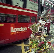 "A memorial has been placed where a young man called 'Carl.' died in Shaftesbury Avenue, London. If we drove past this place where someone's life ended, the victim would just be a statistic but flowers are left to die too and touching poems and dedications are written by family and loved-ones. One reads: ""He was our North, our south/Our east, our West/Our working week and our Sunday rest/Our Noon, our Midnight, our talk, our song/We thought that love would last forever, we were wrong."" From a project about makeshift shrines: Britons have long installed memorials in the landscape: Statues and monuments to war heroes, Princesses and the socially privileged. We also nowadays lay wreaths to the ordinary who die suddenly - killed as pedestrians, as drivers or by alcohol, all celebrated on our roadsides and cities with simple, haunting remembrances."