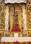Nuestro Padre Jesus Nazareno figure on an altar in the church of San Antonio Abad, Seville, Spain