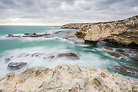 Rugged sandstone coastline with cliffs and bays, Arniston, Western Cape, South Africa