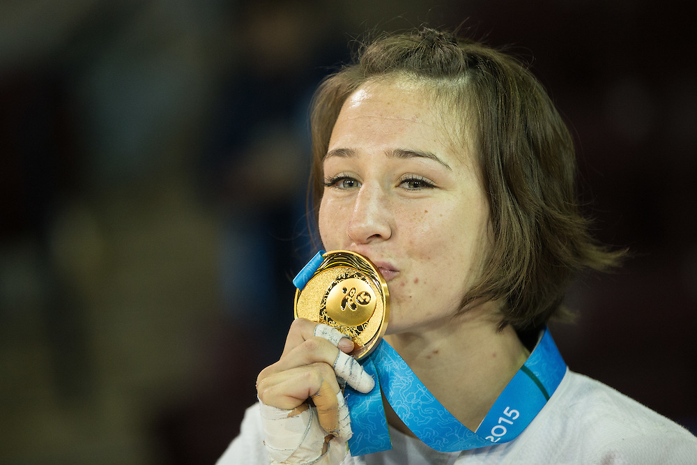 Gold medalist Marti Malloy kisses her medal following the medal ceremony for the women's judo 57kg class at the 2015 Pan American Games in Toronto, Canada, July 12,  2015   AFP PHOTO/GEOFF ROBINS