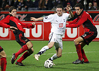 Photo: Paul Thomas.<br /> Bayer Leverkusen v Tottenham Hotspur. UEFA Cup. 23/11/2006.<br /> <br /> Robbie Keane (White) of Spurs tries to go through the Leverkusen defence.