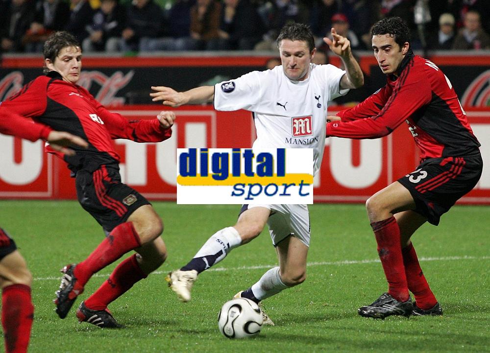 Photo: Paul Thomas.<br /> Bayer Leverkusen v Tottenham Hotspur. UEFA Cup. 23/11/2006.<br /> <br /> Robbie Keane (White) of Spurs tries to go through the Leverkusen defence.
