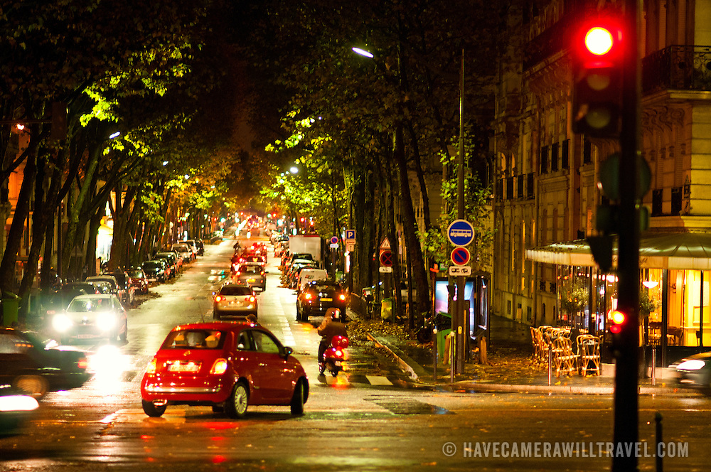 Wet streets in the 7th arrondissement of Paris near the Eiffel Tower at dusk.