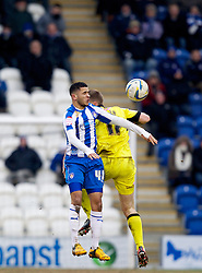 COLCHESTER, ENGLAND - Saturday, February 23, 2013: Tranmere Rovers' Max Power in action against Colchester United's Billy Clifford during the Football League One match at the Colchester Community Stadium. (Pic by Vegard Grott/Propaganda)