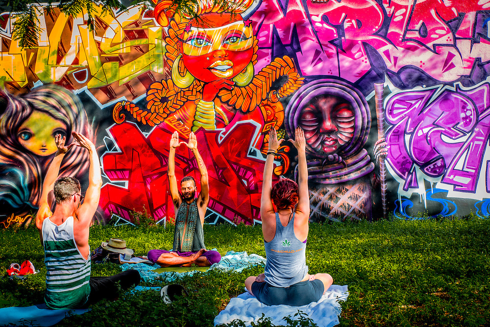 Yoga in Miami's rapidly gentrifying Wynwood district famed for its murals, graffitti and wall paintings which are officially encouraged
