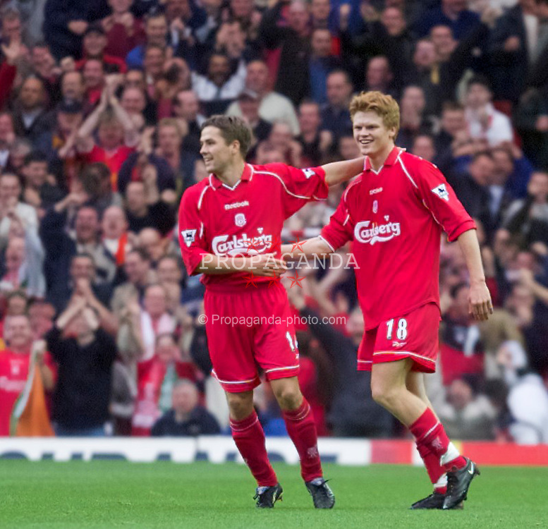 LIVERPOOL, ENGLAND - Sunday, November 4, 2001: Liverpool's John Arne Riise celebrates scoring the second goal with two-goal hero Michael Owen (left) during the Premiership match at Anfield. (Pic by David Rawcliffe/Propaganda)