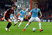 Kevin De Bruyne (17) of Manchester City looks for a way round Chris Mepham (33) of AFC Bournemouth during the Premier League match between Bournemouth and Manchester City at the Vitality Stadium, Bournemouth, England on 2 March 2019.