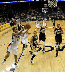 University of Virginia's Lyndra Littles (1) heads towards the basket in action against Wake Forest.  The Cavaliers defeated the Demon Deacon 77-71 on January 11, 2007 for their first ACC win in the John Paul Jones Arena in Charlottesville, VA.<br />