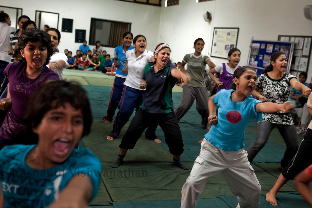 Young girls, working women and elderly ladies participate in a summer camp on self defence training an initiative by the Delhi Police and Special Police Unit for Women and Children at a police station hall in New Delhi, India, on Friday, June 6, 2011. Photographer: Prashanth Vishwanathan/HELSINGIN SANOMAT