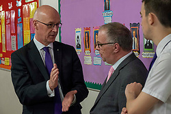 Pictured: John Swinney discussed numeracy with teacher Keith Edwards<br />