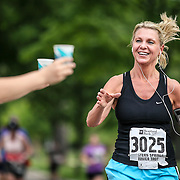 Janet Czajkowski of Oak Forest nears the finish line during the Tower Trot 10k race in Western Springs, Saturday, May 26, 2012.  | J.Geil ~ For Sun-Times Media