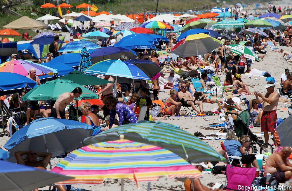 Beach goers enjoy the sun in South Florida.<br />