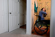 Riley Ljungdahl brushes her hair while getting ready for a school, Friday, May 10, 2013. The first floor of Riley's home was remodeled to make it more accessible. Her bedroom was moved from the second floor to the main level.<br /> (Matthew Jonas/Times-Call)