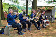 Old Bethpage, New York, U.S. 31st August 2013. L-R, KIRBY JOLLY of Jericho, playing E Flat cornet;  JEREMY KEMPTON of Glen Cove, playing euphomium; JEFF FURMAN of Patchogue, playing tuba; and BOB PRATT of Rockville Centre, drummer, are members of the Old Bethpage Brass Band, performing during the Olde Time Music Weekend at Old Bethpage Village Restoration, where popular music of the American Civil War period is performed, and visitors learn traditional 1800's contradances.