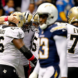 October 7, 2012; New Orleans, LA, USA; New Orleans Saints quarterback Drew Brees (9) celebrates teammates after throwing a touchdown to Devery Henderson (not pictured) to break the NFL record for consecutive games throwing a touchdown at 48 games eclipsing a record once held by Johnny Unitas during the first quarter of a game against the San Diego Chargers at the Mercedes-Benz Superdome. Mandatory Credit: Derick E. Hingle-US PRESSWIRE