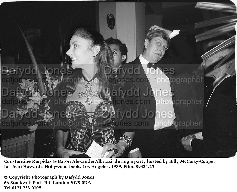 Constantine Karpidas & Baron AlexanderAlbrizzi  during a party hosted by Billy McCarty-Cooper for Jean Howard's Hollywood book. Los Angeles. 1989. Film.89324/25<br />