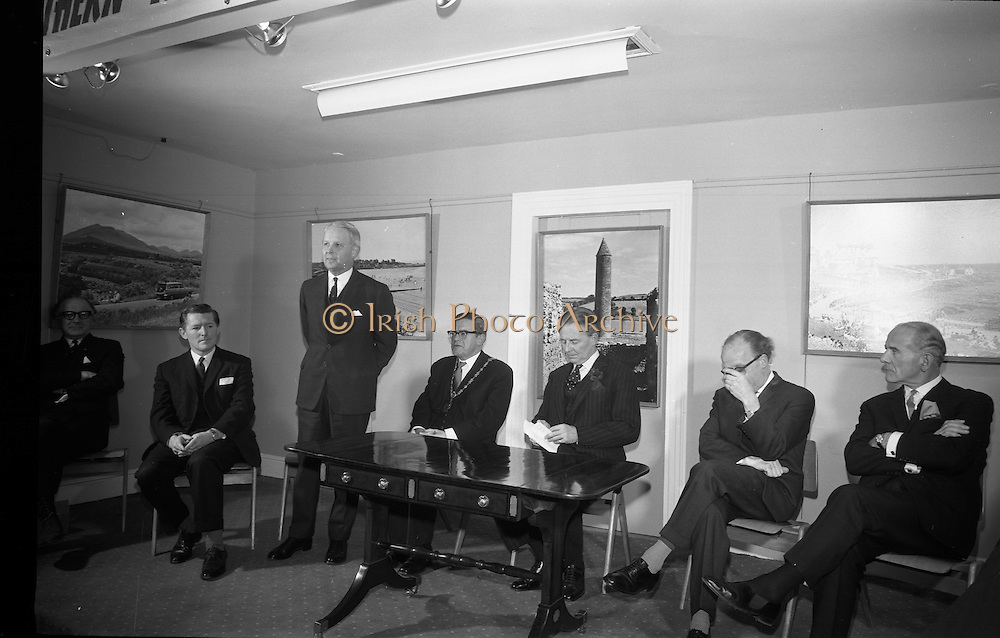 22/03/1966<br /> 03/22/1966<br /> 22 March 1966<br /> Northern Ireland tourist Board Exhibition at the Little Theatre, Brown Thomas in Dublin. Picture shows Mr Brendan O'Regan, Chairman of Bord Failte; Mr Brian Faulkner, Northern Ireland Minister of Commerce, speaking; Alderman Eugene Timmons, Lord Mayor of Dublin; Mr W.L. Stephens, Chairman Northern Ireland Tourist Board; Mr Erskine Childers, Minister for Transport and Power and Dr J.J. O'Driscoll, Director General, Bord Failte.