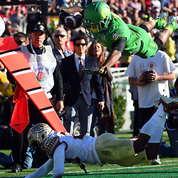 Oregon Ducks wide receiver Charles Nelson (6) dives over Florida State Seminoles defensive back Nate Andrews (29) for a first down at the one yard line in the first half of the 101st Rose Bowl game in Pasadena, California on Thursday, January 1, 2015.