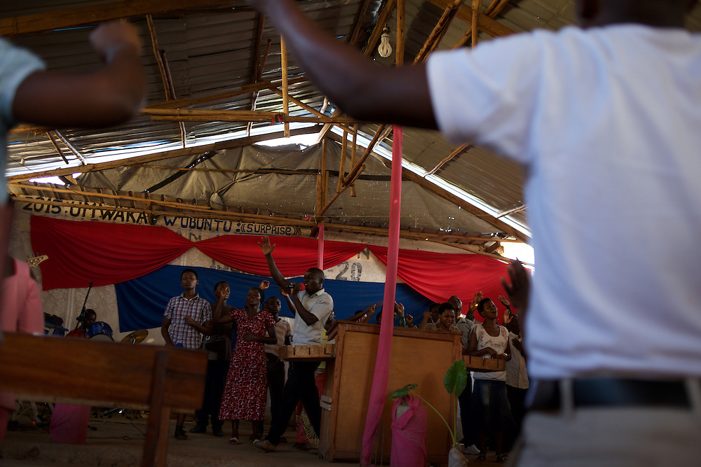 Christian worshippers prays at a church in the flashpoint neighbourhood of Musaga in Bujumbura. Almost five million Burundians will go to the polls on Monday for parliamentary and local elections after weeks of unrest and violence that has forced 100,000 to flee the country. The troubled central African nation of Burundi has been in crisis since late April over President Pierre Nkurunziza's controversial bid to stand for a third consecutive five-year term, a move branded by opponents as unconstitutional and a violation of a peace deal that paved the way to end 13-years of civil war in 2006. Rights groups say over 70 people have been killed in the country's worst political crisis since the war ended a decade ago.