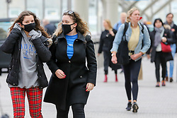 © Licensed to London News Pictures. 01/02/2020. London, UK. Women are seen at Paddington Station wearing a fashionable face masks following the outbreak of Coronavirus in Wuhan, China. According to Twitter two people were taken to hospital from Paddington Station on the evening of Friday 31 January, amid fears that Coronavirus has speed to London. Part of the station was cordoned off following a woman sitting on a bench, while staff in face masks keep guard. Photo credit: Dinendra Haria/LNP
