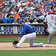 Lucas Duda, New York Mets, makes the out at first base as  Marlon Byrd, Cincinnati Reds, reaches for the base during the New York Mets Vs Cincinnati Reds MLB regular season baseball game at Citi Field, Queens, New York. USA. 28th June 2015. Photo Tim Clayton