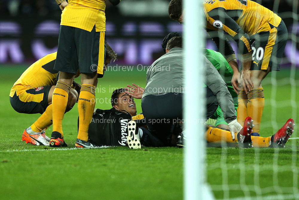 Gabriel of Arsenal receives medical treatment for an injury. Premier league match, West Ham Utd v Arsenal at the London Stadium, Queen Elizabeth Olympic Park in London on Saturday 3rd December 2016.<br /> pic by John Patrick Fletcher, Andrew Orchard sports photography.
