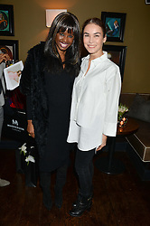 Left to right, JUNE SARPONG and CINDY BILTON at a party to launch Madderson London Women's Wear held at Beaufort House, 354 Kings Road, London on 23rd January 2014.