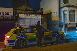 © Licensed to London News Pictures. 06/05/2020. London, UK. A Metropolitan police officer stands next to a police car outside an alleyway on Park Road. A Metropolitan Police officer has been assaulted after a vehicle pursuit in West Hendon. A man decamped from the vehicle and was located by an officer in an alleyway on Park Road. A struggle ensued, and the officer was seriously assaulted. The suspect fled the scene prior to police back up arriving. The man was located by police officers and arrested on suspicion of attempted murder. Photo credit: Peter Manning/LNP