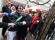 2/2/2011.Labour leader Eamon Gilmore pictured on the campaign trail in Kilkenny yesterday with Elvis impersonator Myles Kavanagh and  Carlow Kilkenny candidates  Cllr Ann Phelan and Cllr Des Hurley (left shoulder)..Picture Dylan Vaughan....