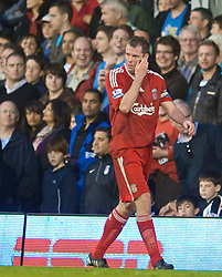 LONDON, ENGLAND - Saturday, October 31, 2009: Liverpool's Jamie Carragher walks off dejected after being unfairly sent-off against Fulham during the Premiership match at Craven Cottage. (Pic by David Rawcliffe/Propaganda)