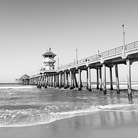 Huntington Pier black and white photo in Huntington Beach, California. Huntington Beach Pier is a registered historic place located along the Pacific Ocean in Orange County California. Image Copyright © 2012 Paul Velgos with All Rights Reserved.