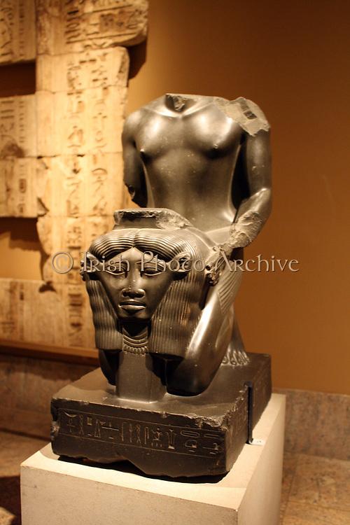 Kneeling statue of Amenemope-em-hat.  Dynasty 26, reign of Psamtik 1 (664-610 BC) From Memphis, Ptah Temple.