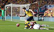 Arsenal's Héctor Bellerín beats Kieran Richardson of Aston Villa during the The FA Cup match between Arsenal and Aston Villa at Wembley Stadium, London, England on 30 May 2015. Photo by Phil Duncan.