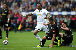 """Swansea City's Jordan Ayew (centre) and Newcastle United's Ciaran Clark (second right) battle for the ball during the Premier League match at the Liberty Stadium, Swansea. PRESS ASSOCIATION Photo. Picture date: Sunday September 10, 2017. See PA story SOCCER Swansea. Photo credit should read: Nick Potts/PA Wire. RESTRICTIONS: EDITORIAL USE ONLY No use with unauthorised audio, video, data, fixture lists, club/league logos or """"live"""" services. Online in-match use limited to 75 images, no video emulation. No use in betting, games or single club/league/player publications."""