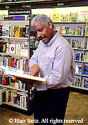 Active Aging Senior Citizens, Retired, Activities, Shopping. Aged African American Male Browses in Bookstore, Staying Young