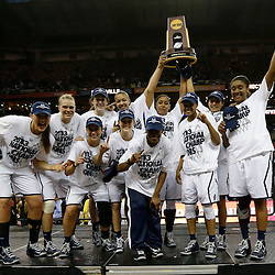 Apr 9, 2013; New Orleans, LA, USA; Connecticut Huskies players celebrate with the championship trophy after the championship game in the 2013 NCAA womens Final Four against the Louisville Cardinals at the New Orleans Arena. Connecticut defeated Louisville 93-60. Mandatory Credit: Derick E. Hingle-USA TODAY Sports