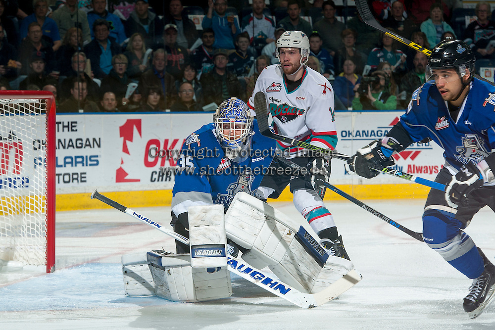 KELOWNA, CANADA - APRIL 14: Rourke Chartier #14 of Kelowna Rockets looks for the pass as Coleman Vollrath #35 of Victoria Royals defends the net during first period on April 14, 2016 at Prospera Place in Kelowna, British Columbia, Canada.  (Photo by Marissa Baecker/Shoot the Breeze)  *** Local Caption *** Coleman Vollrath; Rourke Chartier;